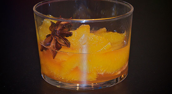 Citrus fruits in star anise  and cardamom flavored syrup