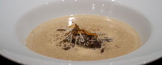 Funnel chanterelle soup with calvados and parmesan cheese
