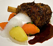 Leg of lamb with root vegetables, red wine sauce and chevre and thyme foam