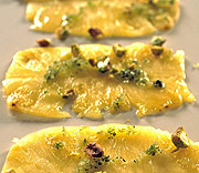Pineapple carpaccio with mint sugar and pistachios