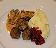 Wild meatballs with mushroom sauce and cranberries